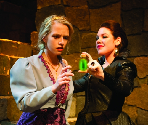 The sinister Queen (Sammie Lideen) proposes a 'magical elixir' for her stepdaughter, Imogen (Brooke Hartnett), in Shakespeare's CYMBELINE, playing Feb 24 – Mar 24, 2013 at UA Arizona Repertory Theatre.By GABRIELA DIAZ